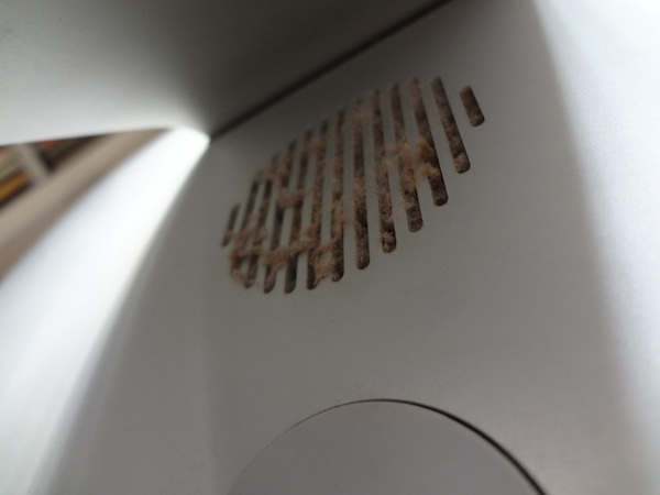 Hidden behind the foot of the iMac above the power cord is this ventilation hole.